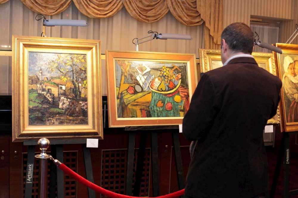 Halucinant! Spaga camuflata in opere de arta. Au cumparat un tablou cu 1000 lei si au spalat 250.000 euro prin vanzari succesive